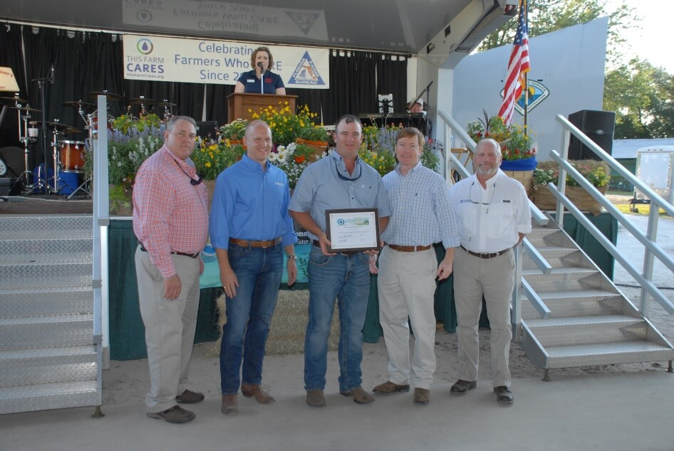 Pictured left to right: Kevin Morgan, FFBF, Noah Velenstein, SRWMD, CARES Recipient Lyles Corbin, Commissioner Adam Putnam and Jack Payne, UF/IFAS.