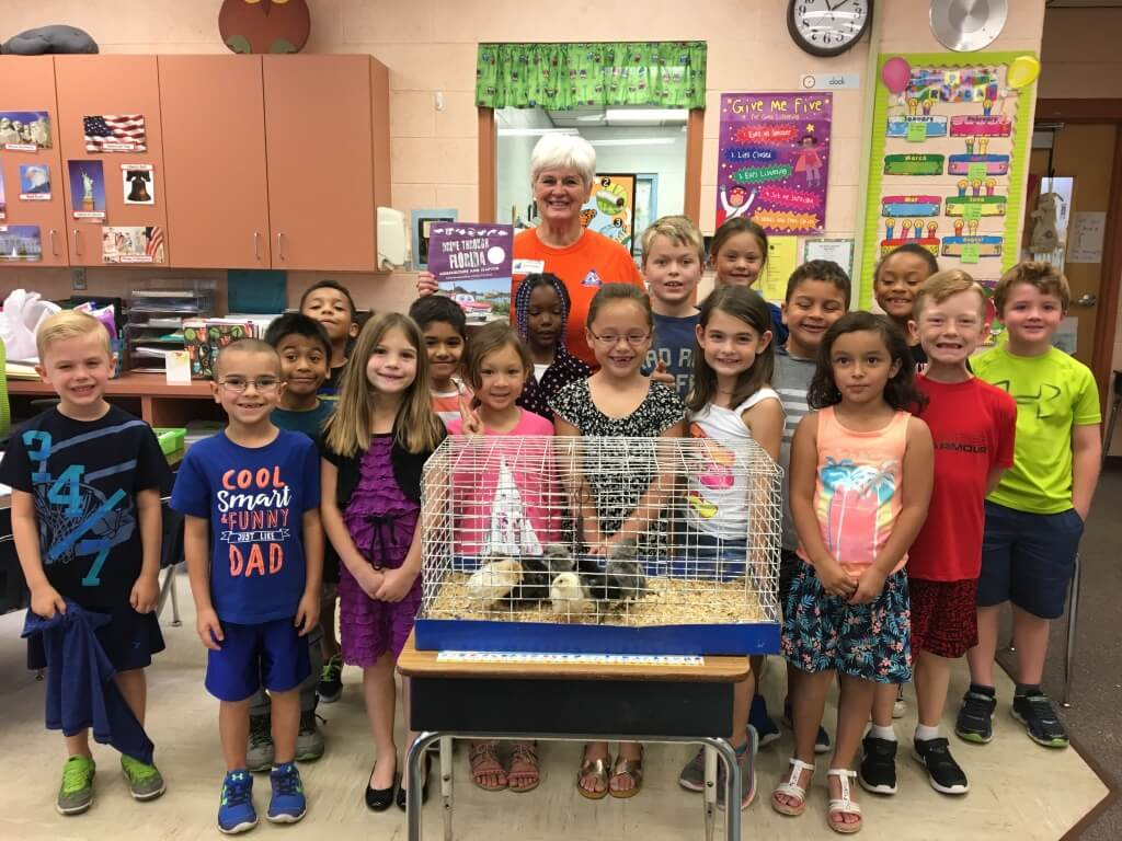 Susan Hendry reading to a class for Ag Literacy Day. Susan was named Florida Farm Bureau's 2016 Volunteer Communicator of the Year.