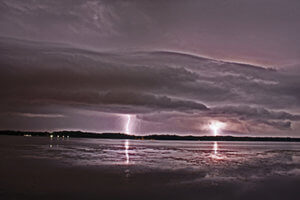 Lightening strikes over the water
