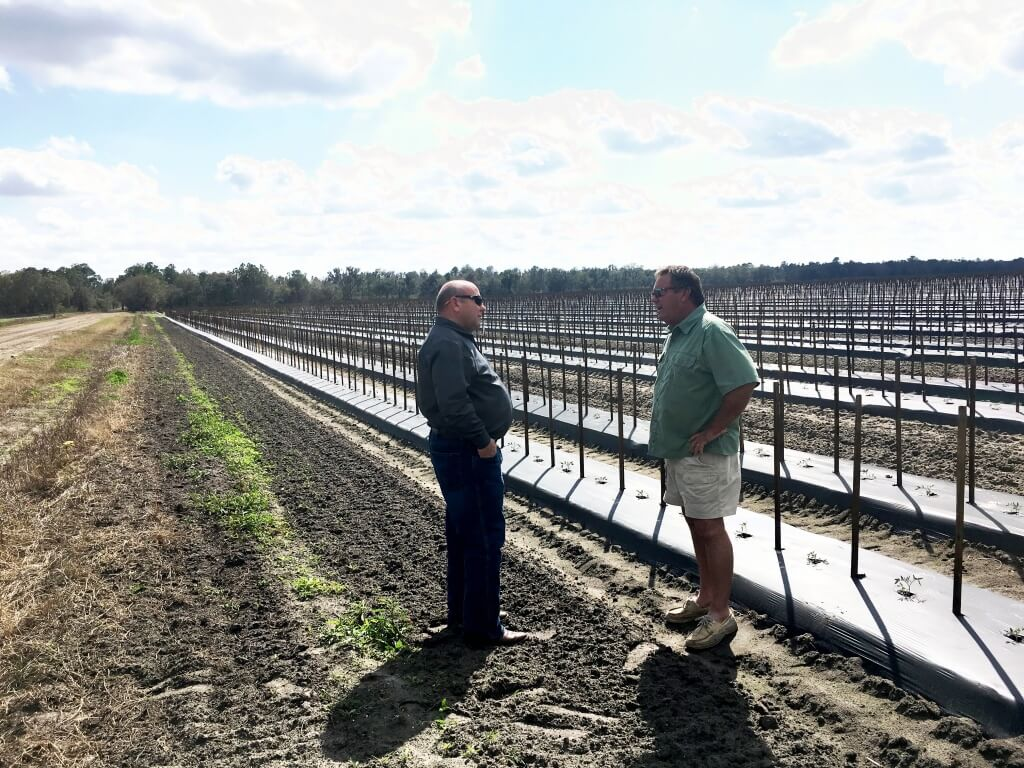 Gary Reeder (right) visits with AFBF President Zippy Duvall during a tour of Reeder's farm.